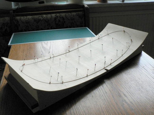 Figure 1. The jig used to build the dry wing structure. The top surface is made from a sheet of thin flexible plywood.